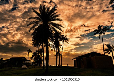 Beautiful sunset and paradise beach, nice silhouettes At Alii Beach Park in Haleiwa town at the Northshore of Oahu island, Hawaii USA