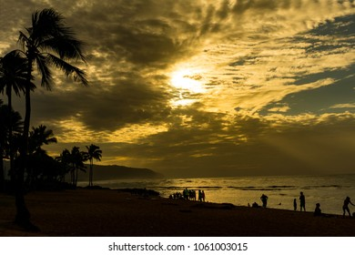 Beautiful sunset and paradise island with nice silhouette at Alii Beach Park in Haleiwa town at the Northshore of Oahu Island, Hawaii USA