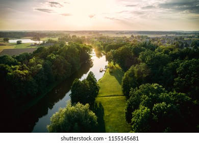 Beautiful sunset in the park near small Pajiesmeniai village in Lithuania. Aerial photo.