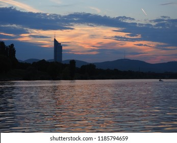 Beautiful sunset photo of a river Danube in Vienna, colourful landscape