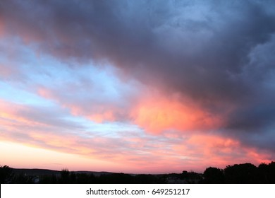Beautiful sunset with pink and orange clouds. Evening sky background.