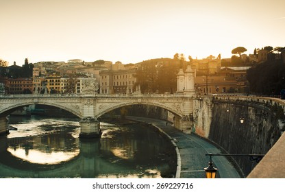 Beautiful sunset at Ponte Vittorio Emanuele II in Rome, Vatican City scenery over Tiber river.