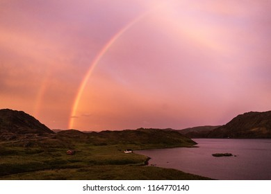 Beautiful sunset with rainbow near Nordkapp, Finnmark, Northern Norway