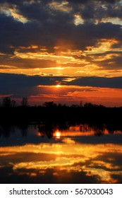 Beautiful sunset reflected in the Desna River, which overflowed in the spring.