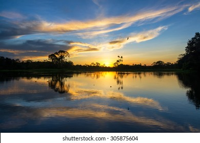 Beautiful sunset reflected on the Yanayacu River in the Amazon rain forest in Peru