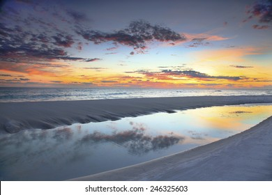 A Beautiful Sunset Reflected in a Tide Pool at the Beach