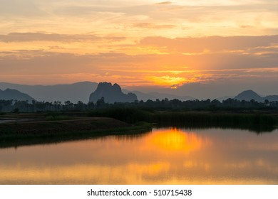 Beautiful sunset with reflection in the countryside of Thailand.