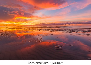 beautiful sunset with reflection fine art for background. Image may contain soft focus and blur due to long expose.