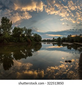 Beautiful sunset reflection over wild river