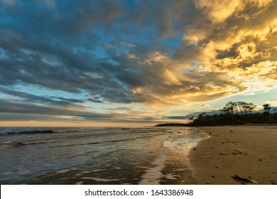 A beautiful sunset reflects the light on the Atlantic Ocean at Hunting Island State Park on St. Helena Island near Beaufort, South Carolina