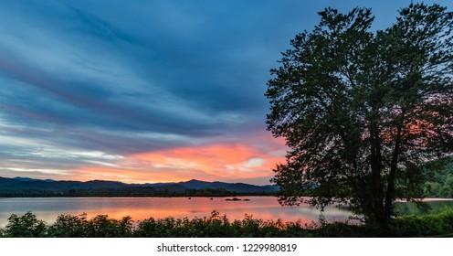 Beautiful sunset reflects over Lake Wison after flooding rains i