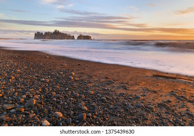 Beautiful sunset at Rialto Beach, Olympic National Park.  The beach is located on the Pacific Ocean in Washington state, USA