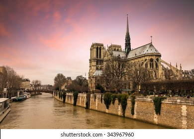 Beautiful sunset at the river Seine with the Notre-Dame Cathedral in Paris