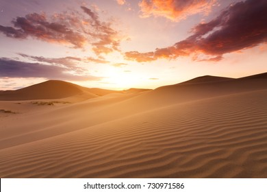 Beautiful sunset in the Sahara desert. Sand dunes at sunset