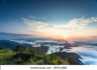 a beautiful sunset scene, mountain with sea of mist at Pha Tang, Chiangrai, Thailand