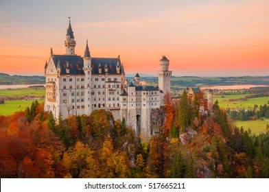 Beautiful sunset scene on Neuschwanstein Castle with colorful sky and autumn trees. Bavaria, Germany.