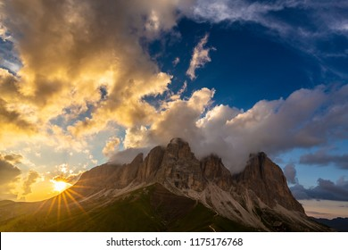 Beautiful sunset scenery in the Dolomite mountains, with mist clouds, after rain