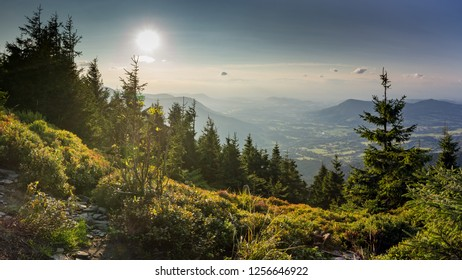 Beautiful sunset scenery on Smrk mountain in Moravskoslezske Beskydy in Czech republic with clear sky and only few clouds during late summer with Ondrejnik and Radhost.