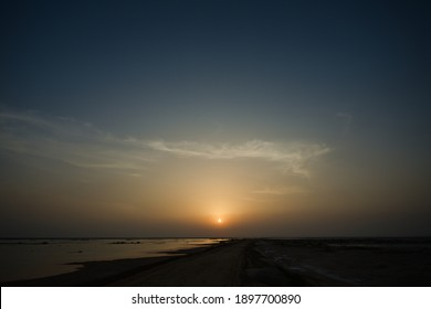 A beautiful sunset scenery over the waterscape in Qatar