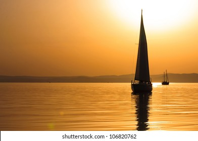 Beautiful sunset at the sea with boats