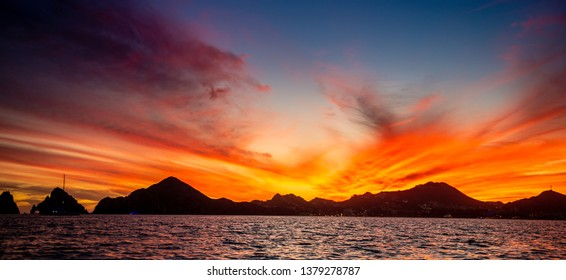 Beautiful Sunset of Seascape with Mountains silhouets. Sea off the Coast of Cabo San Lucas. Gulf of California (also known as the Sea of Cortez, Sea of Cortes. Mexico.