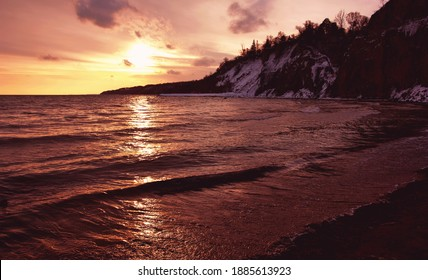 A beautiful sunset as seen from Toronto's Scarborough Bluffs' beach in winter.