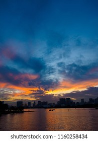 It is a beautiful sunset seen from the seaside. This place is Odaiba Beach Park in Tokyo, Japan. Clouds are dyed red beautifully. It is a very brilliant piece.