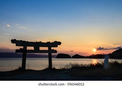 Beautiful sunset with shrine  in Naoshima Island, Japan.
