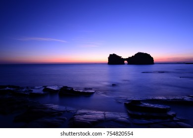 Beautiful Sunset with silhouette of Engetsuto Island in Shirahama, Wakayama, Southern Japan