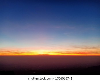 Beautiful sunset sky above clouds with dramatic light, Panoram mountain and dramatic sky sunset background, Nature in twilight period, purple sky at the sunset.