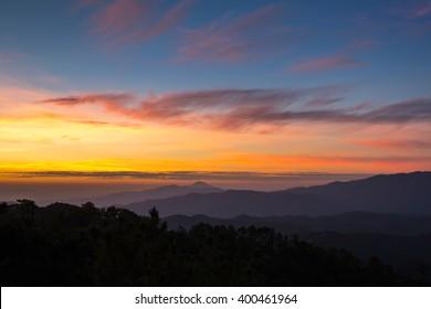 Beautiful sunset sky and clouds over mountain at Huai Nam Dang, Chiang Mai, Thailand.