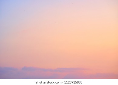 Beautiful sunset sky. Nature background. Light peach and light purple colors.