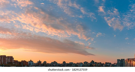 Beautiful sunset sky over city. Twilight over urban district. Aerial view. Typical modern residential area. Kyiv. Ukraine. Wide panorama.