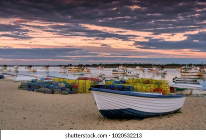Beautiful sunset sky over Puerto Umbria fishing port in Huelva, Southern Spain; selective focus.