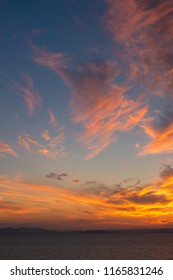 Beautiful sunset sky over the sea, vertical. Nature, weather, atmosphere, travel theme.