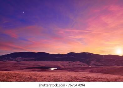 Beautiful sunset sky over ski centar Tornik and mountain pastures in Zlatibor, Serbia.