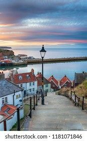 Beautiful sunset sky over Whitby on the North Yorkshire coast at the 199 Steps leading down to the harbour