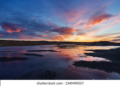 Beautiful sunset sky reflecting on water, Antelope Island State Park, Utah