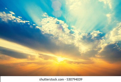 Beautiful sunset sky with sun rays. Nature background.