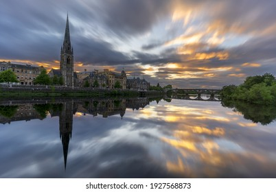 Beautiful sunset at St Matthew's Church on River Tay with reflection , Perth , Scotland
