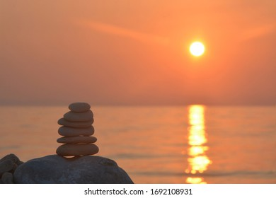 Beautiful sunset with stones on the beach