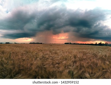 Beautiful sunset and storm clouds over the fields, on the last day of spring, in Biskupice Podgorne near Wroclaw, Poland.