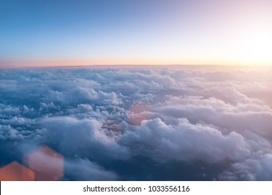 Beautiful sunset or sunrise with cloudy sky from the airplane window.