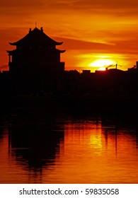 Beautiful Sunset and the Temple Reflection in Tainan, Taiwan