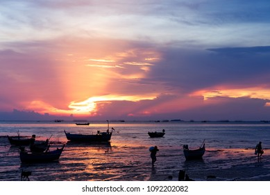 Beautiful sunset with Thai traditional boat at North Pattaya beach in Thailand.