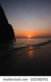 beautiful sunset at Tham Phra Nang Beach, Krabi,