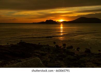 Beautiful sunset at toey ngam beach Sattahip Chonburi,Thailand