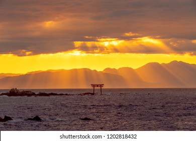 Beautiful sunset torii with crepuscular rays in Japan