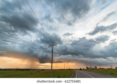 Beautiful sunset tornado whit the horizon line , would make a great and very easy extractable background to incorporate into designs