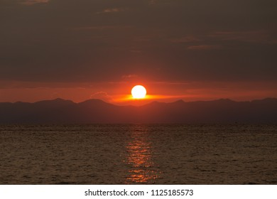 Beautiful sunset in tropical sea background.